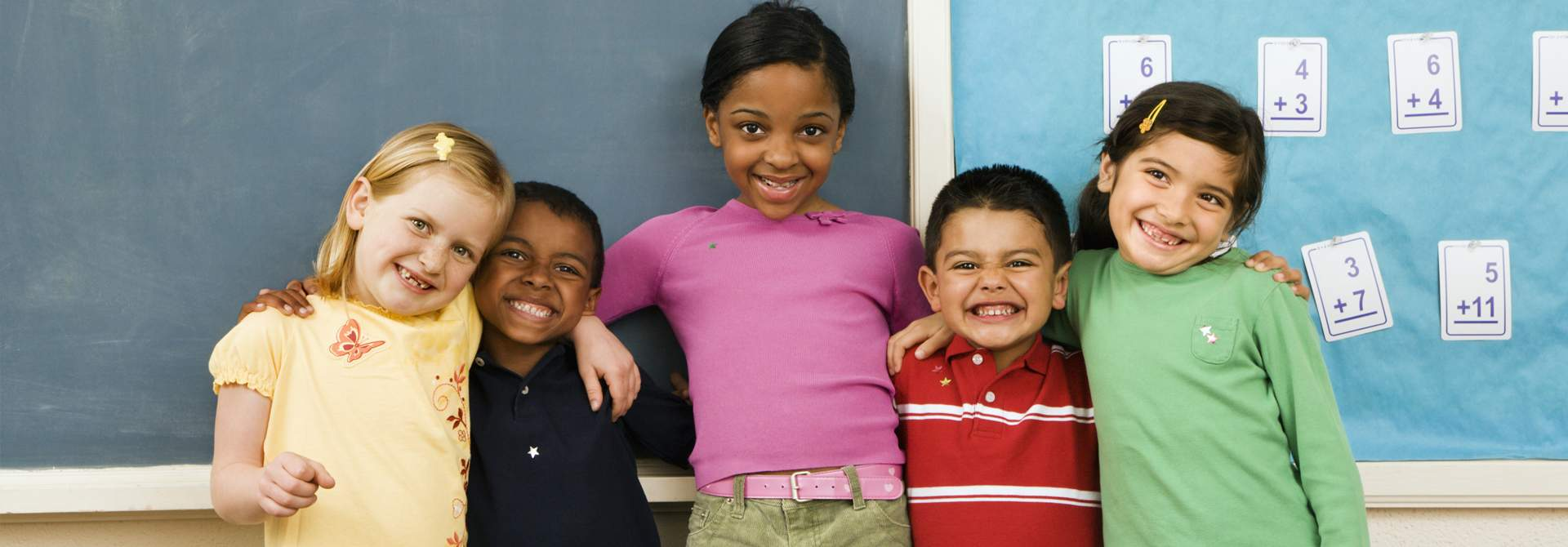 banner image with five smiling children