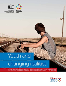 Cover showing a youth sitting on rail tracks facing away
