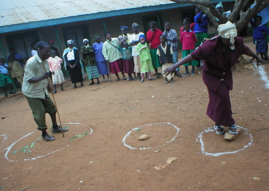 People standing in semi-circle watching a man and a woman role playing