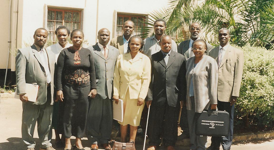 A group of well dressed adults posing for a picture